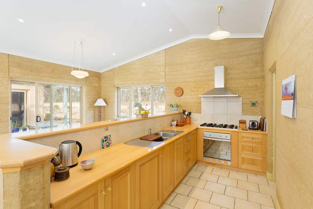 Rammed earth kitchen in home for sale