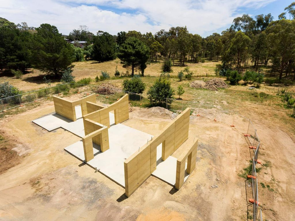 rammed earth construction on solar passive family home