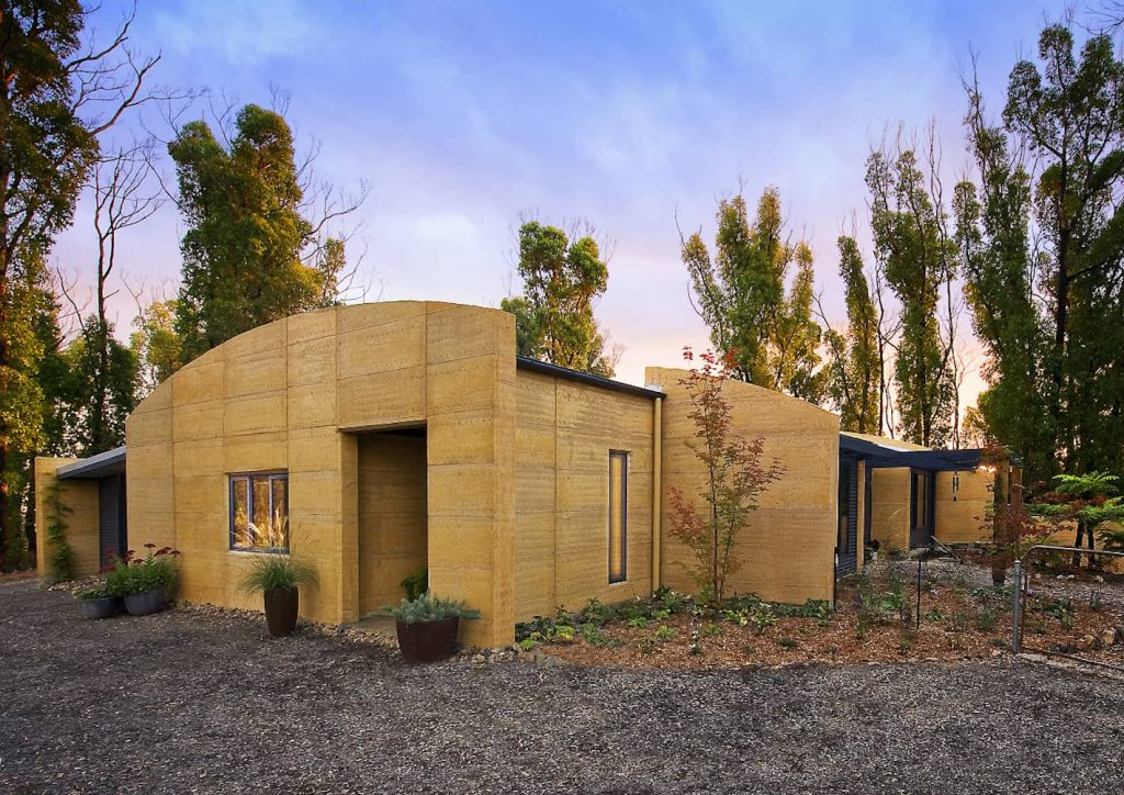 Unique curved rammed earth walls